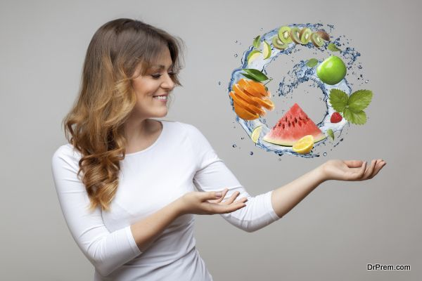 smiling woman with fruits and water splash