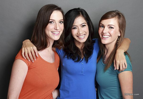 portrait of attractive multi racial three girls best friend together having fun