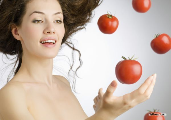 a girl with a ripe red tomato