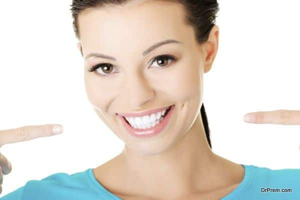 beautiful casual woman showing her perfect white teeth. Isolated on white.