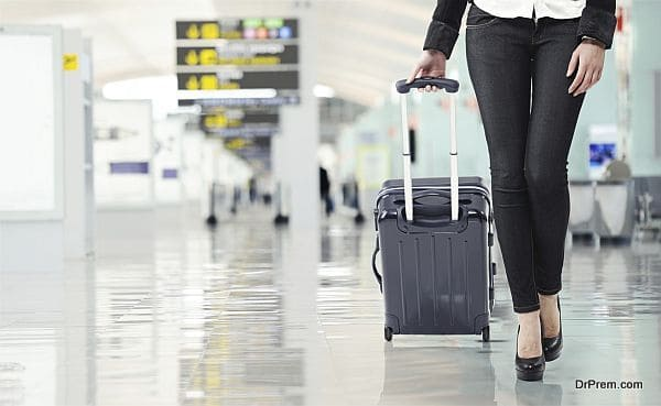 Young woman pulling luggage at the airport