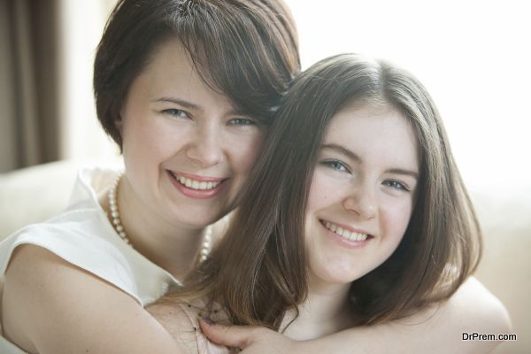 Mother and daughter happy embrace.
